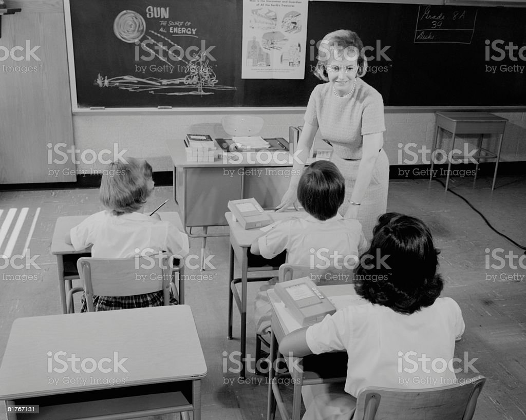 Teacher and pupils (8-11) during lesson royalty-free stock photo