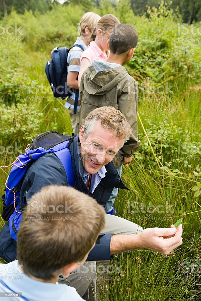 Teacher and pupils on field trip royalty-free stock photo