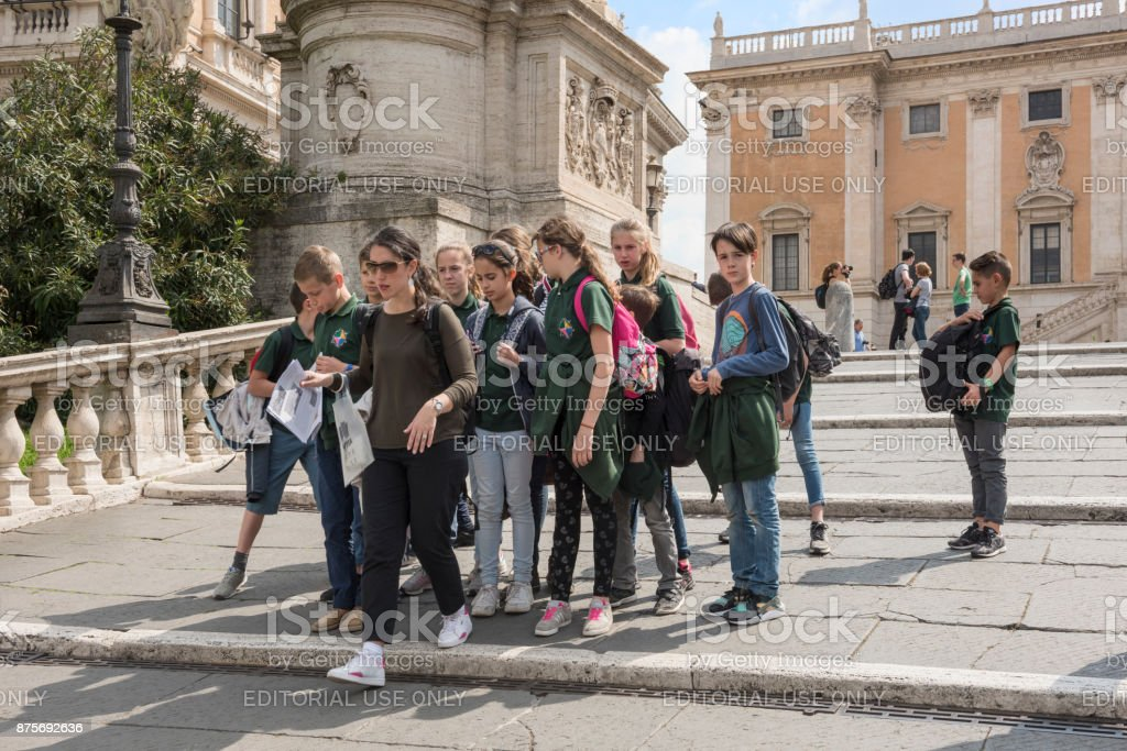 Teacher and school class on excursion at the Capitoline Museums stock photo