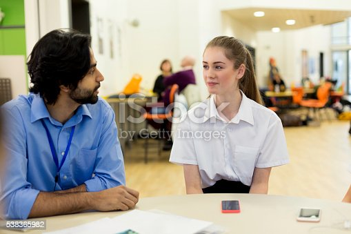 istock Teacher and Student Chatting 538365982