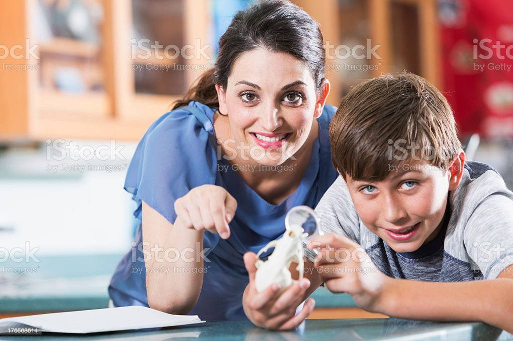 Teacher and student in science class royalty-free stock photo