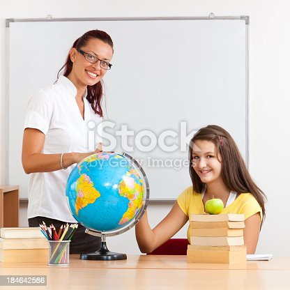 639569206 istock photo Teacher And Student On Geography Class 184642586