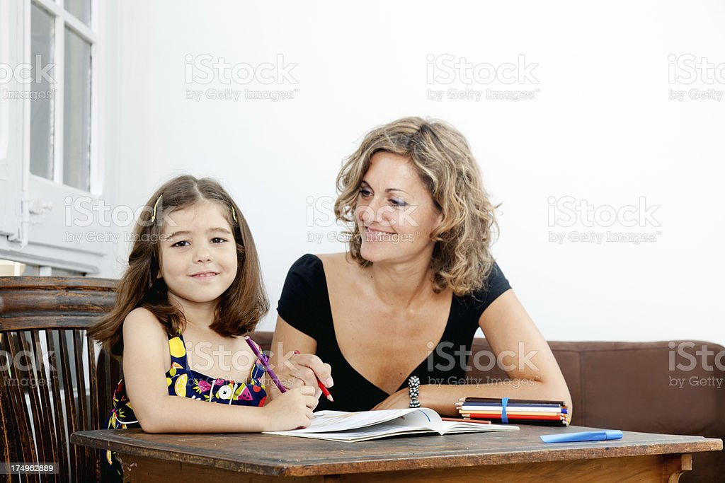 Teacher an little student girl.More Education shots at this lightbox: