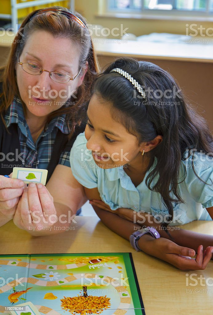 Teacher And Student playing A Seasons Board game In Class royalty-free stock photo