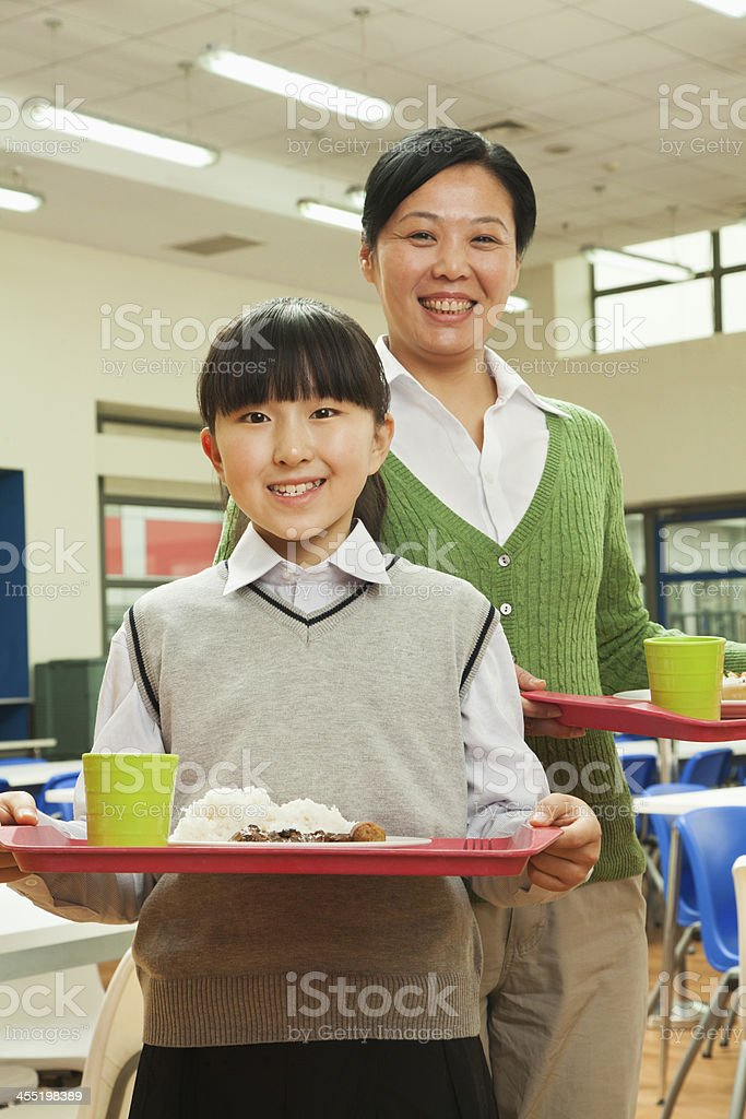 Teacher and student portrait in school cafeteria royalty-free stock photo