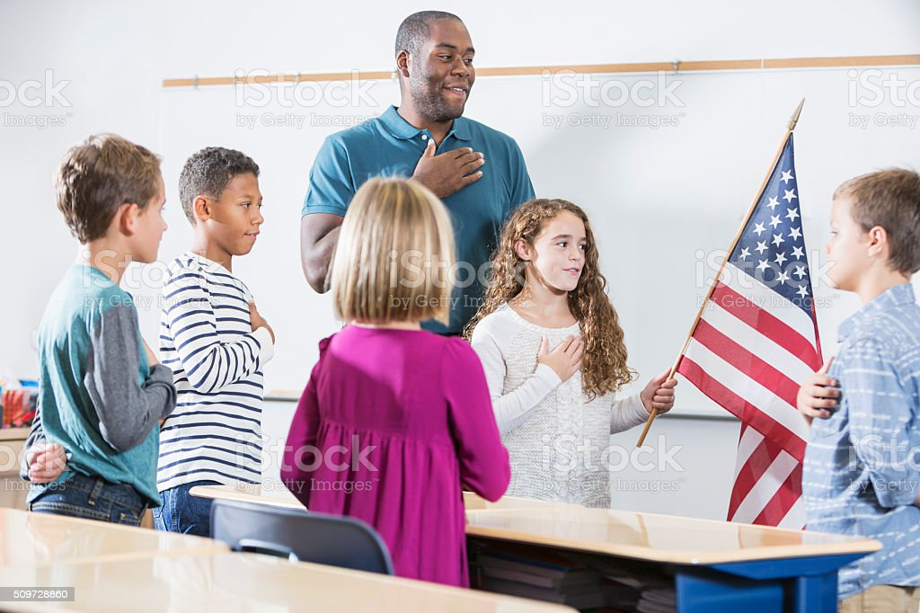 Teacher and students, American pledge of allegiance stock photo