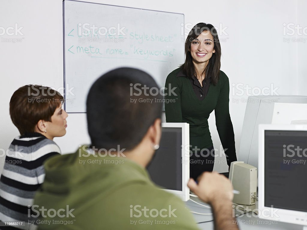 Teacher and students in college royalty-free stock photo