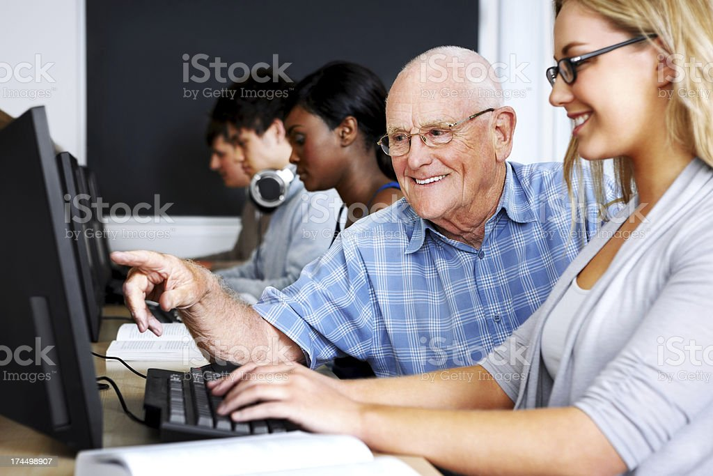 Teacher and students in computer class royalty-free stock photo