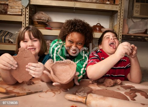 istock Teacher and young students in clay studio 97129635