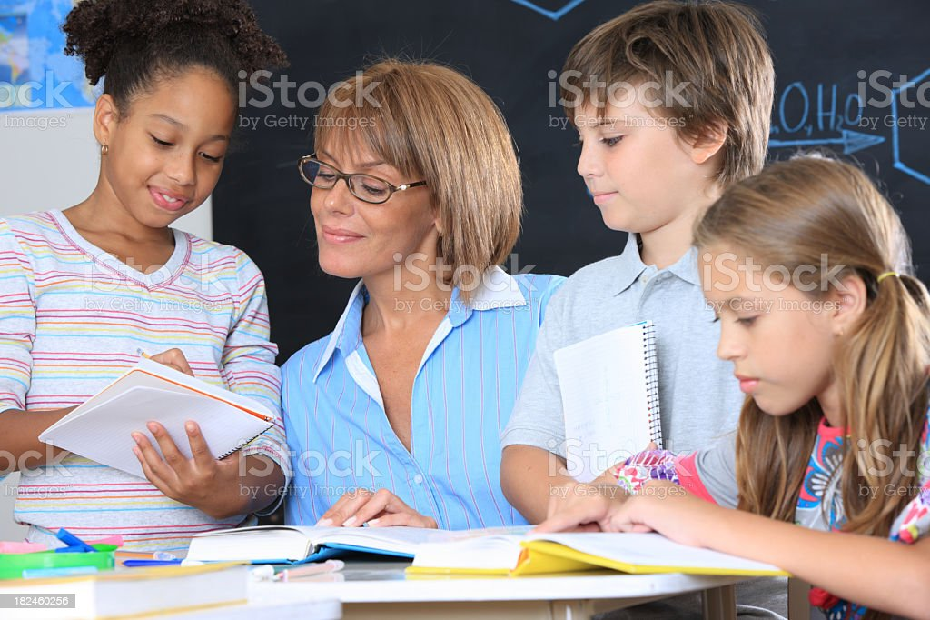 Teacher ans students in a classroom royalty-free stock photo