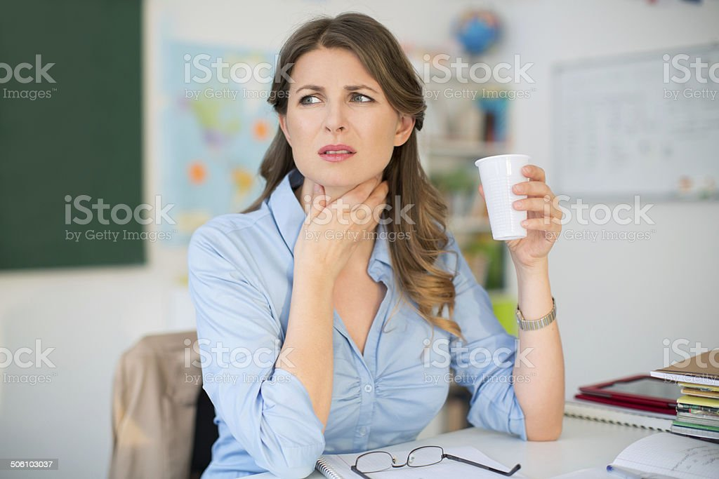 Teacher at classroom. stock photo