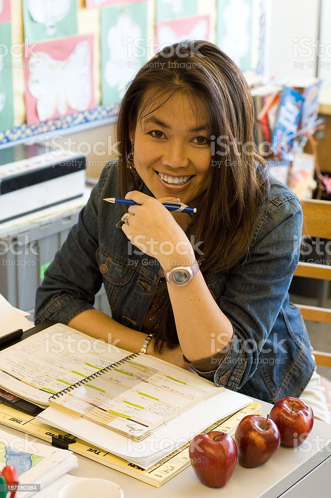 Teacher At Desk stock photo