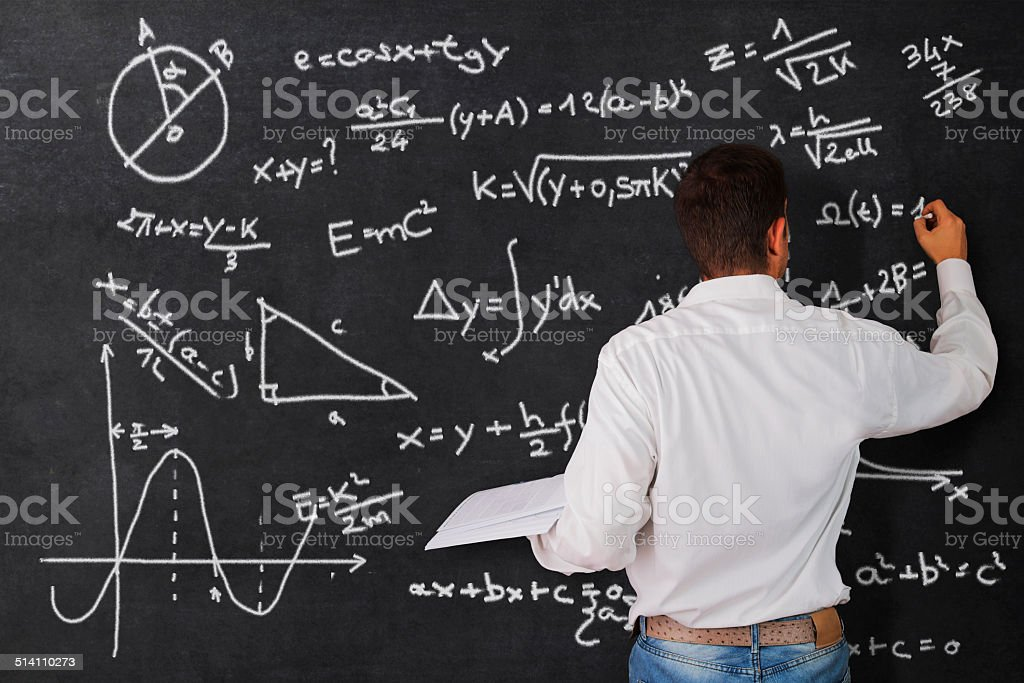 Teacher at the blackboard stock photo