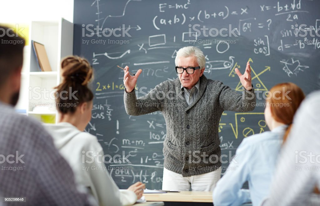 Teacher by blackboard stock photo