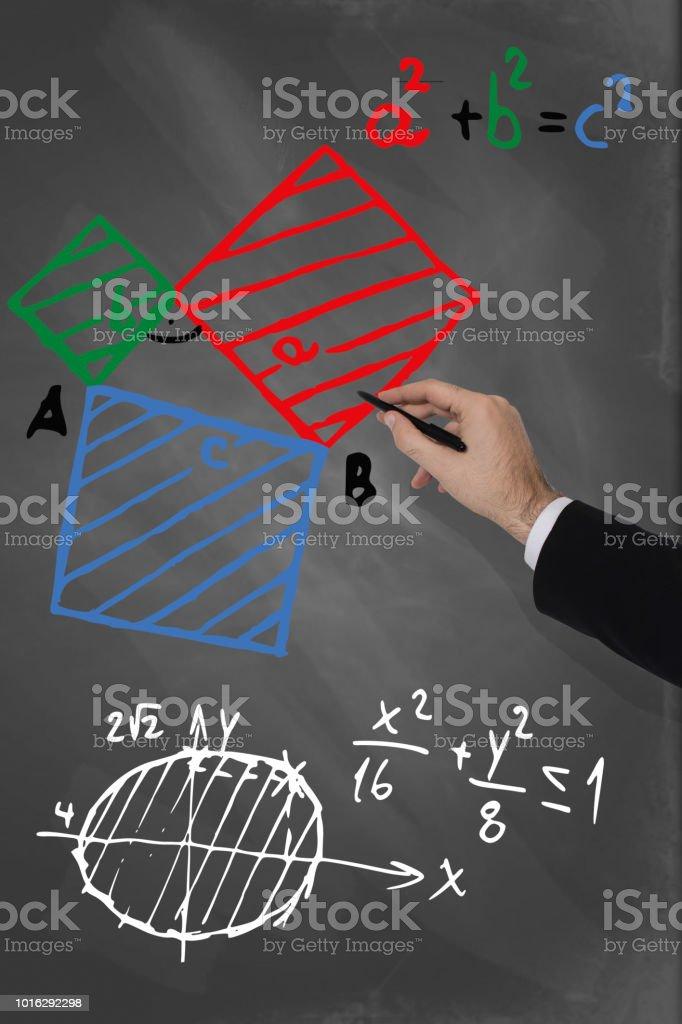 Teacher calculating angles on a blackboard stock photo