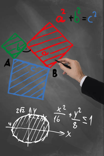Teacher calculating angles on a blackboard stock photo