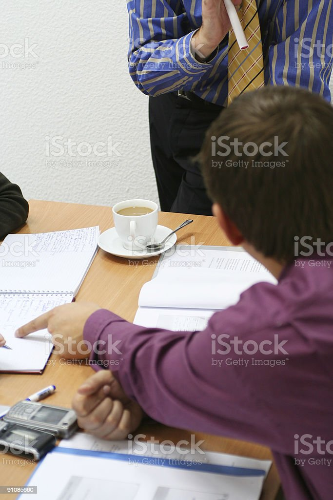 Teacher consulting students on the seminar royalty-free stock photo