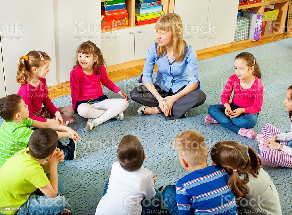 Teacher discussing with children. royalty-free stock photo