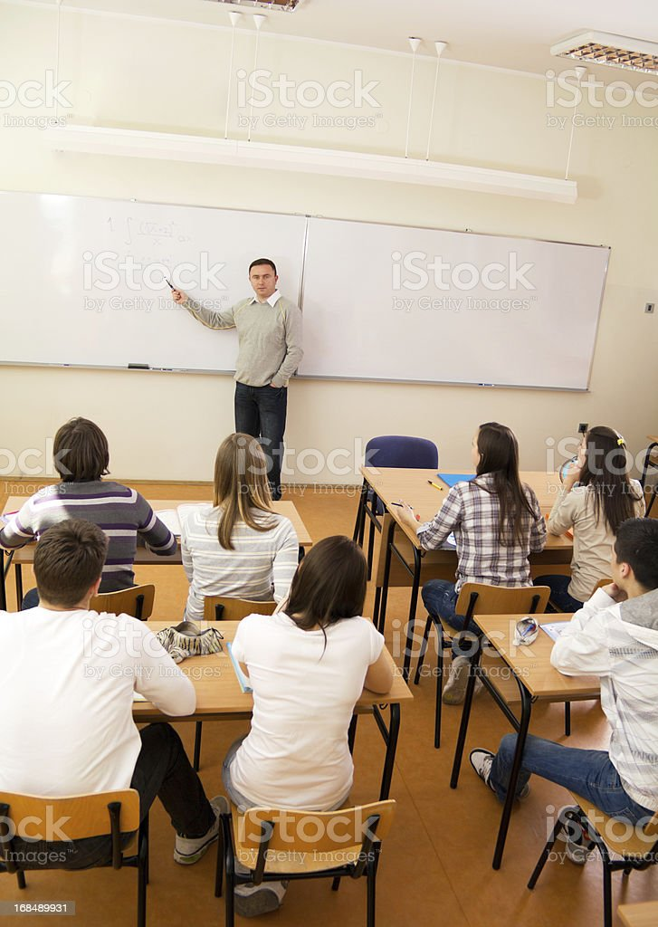 Teacher explaining a lesson to students. royalty-free stock photo