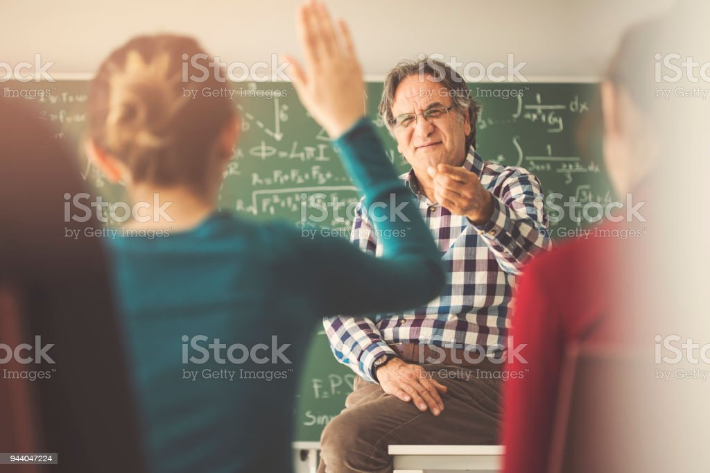 Teacher giving lesson in classroom foto stock royalty-free