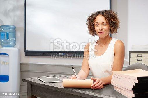 istock teacher grading work 516648496