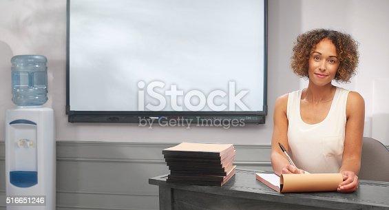 istock teacher grading work 516651246