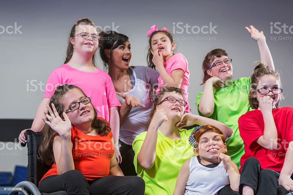Teacher, group of special needs girls and young women stock photo