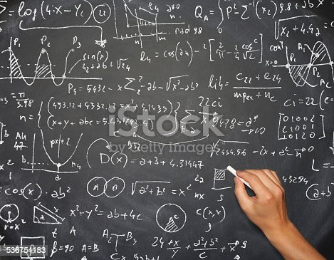 istock Teacher hand writing complicated math formula on blackboard 536754183