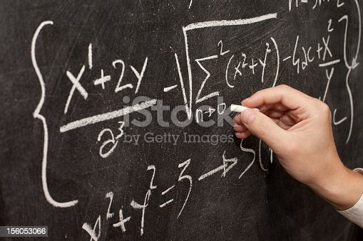 896307096 istock photo Teacher hand writing complicated math formulas on blackboard 156053066