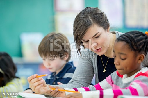 istock Teacher Helping a Student Understand an Assignment 507749622