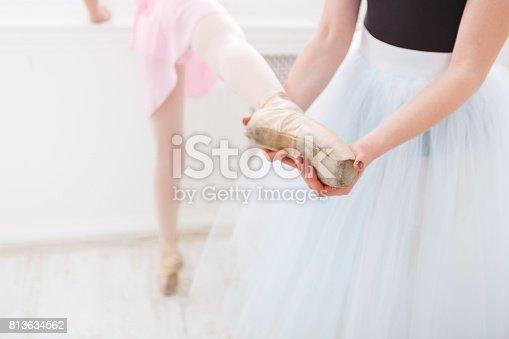 istock Teacher helping her student during dance class 813634562