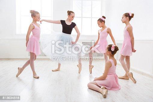 istock Teacher helping her students during dance class 813634518
