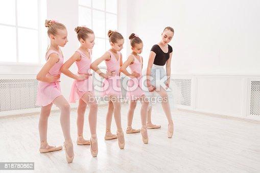 istock Teacher helping her students during dance class 818780862