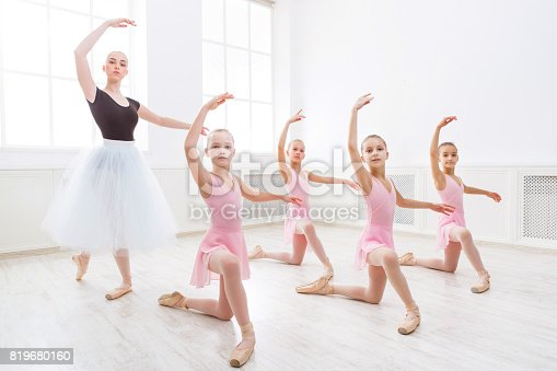 istock Teacher helping her students during dance class 819680160