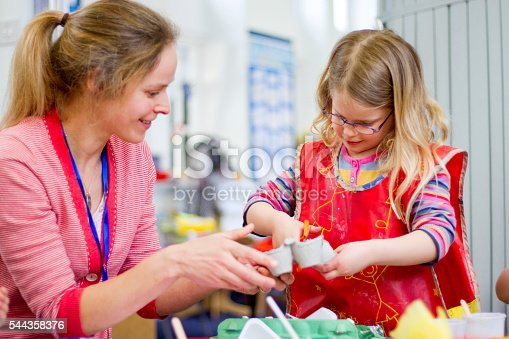 544351868 istock photo Teacher Helping in Arts and Crafts 544358376