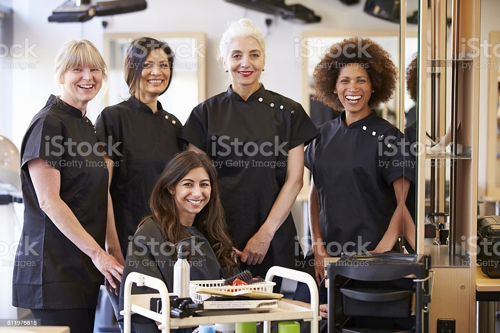 Teacher Helping Mature Students In Hairdressing stock photo