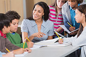 istock Teacher helping students in classroom 474710229