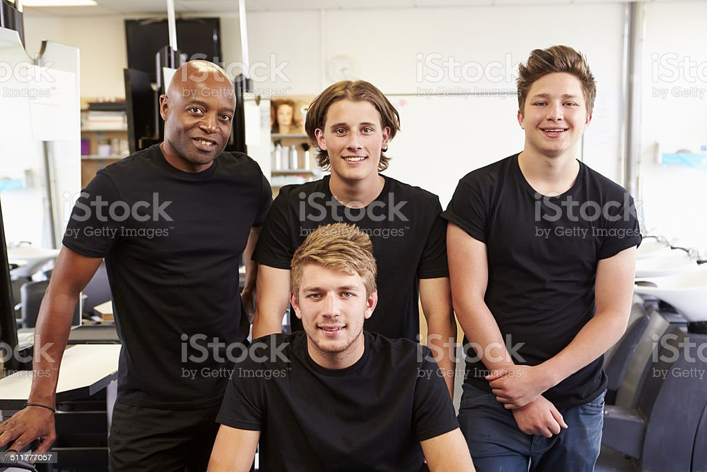 Teacher Helping Students Training To Become Hairdressers stock photo