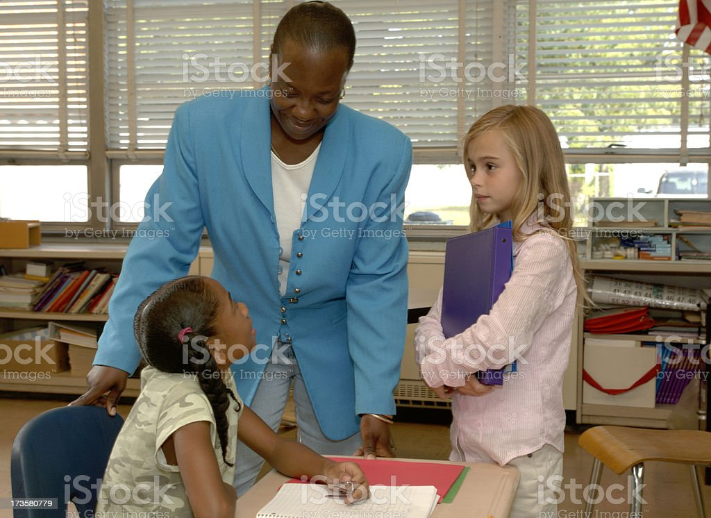 Teacher helps a student royalty-free stock photo