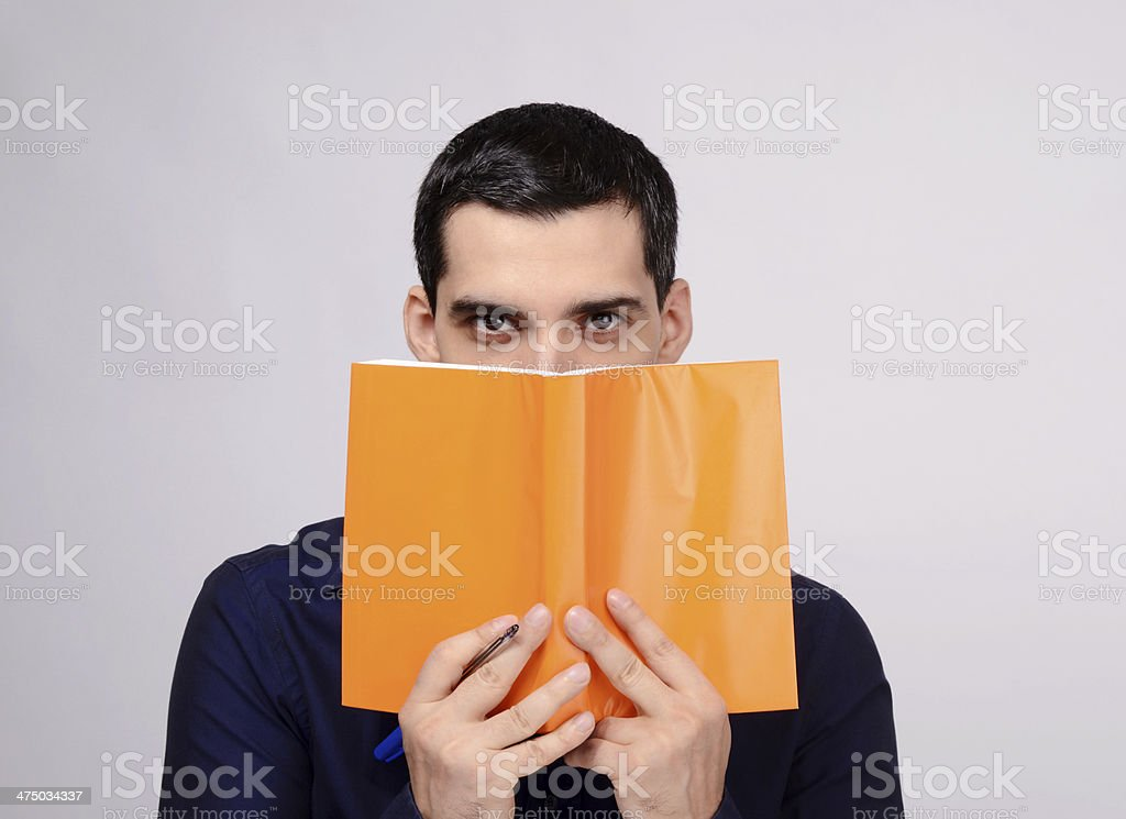 Teacher holding a book with blank orange cover. royalty-free stock photo