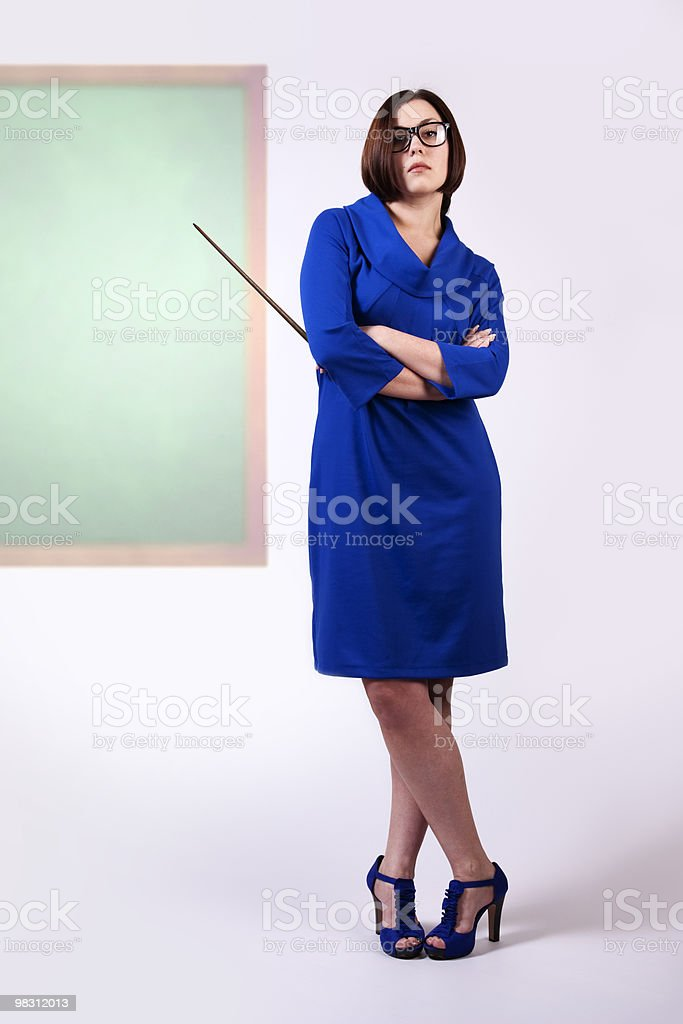Teacher in blue royalty-free stock photo