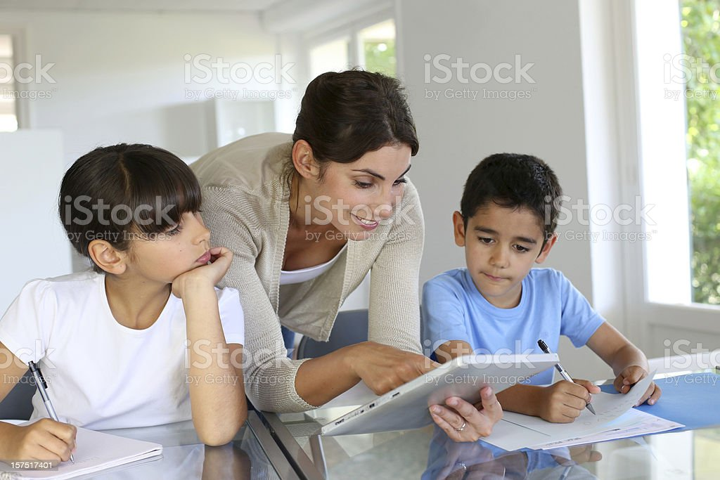 Teacher in class wiht pupils stock photo