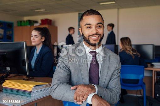 641755548 istock photo Teacher in Computer Class 901883398