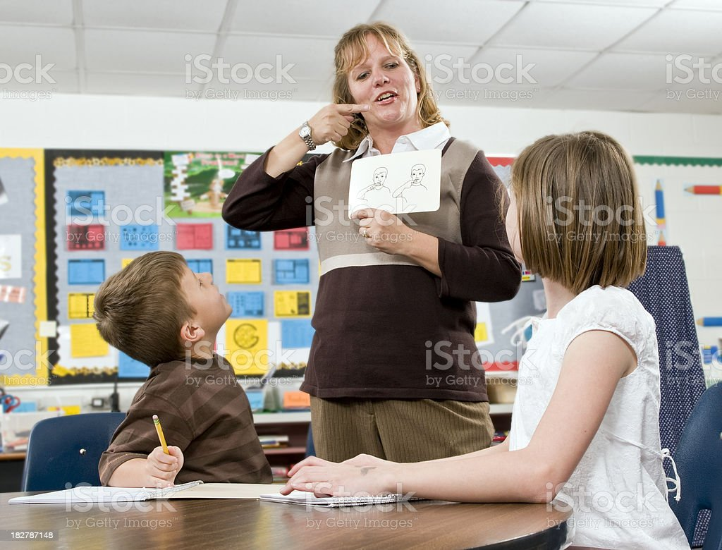 Teacher in the classroom stock photo