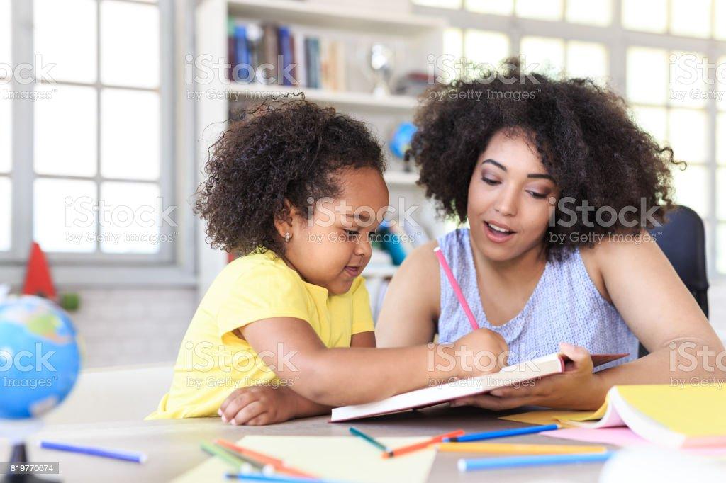 Teacher learning little girl stock photo