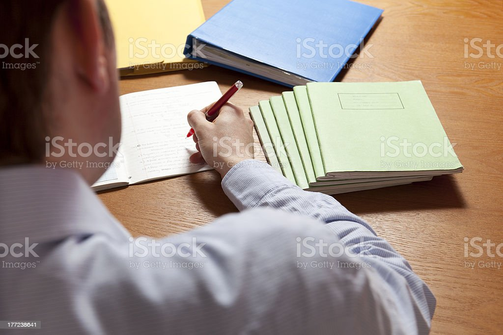 Teacher Marking / Grading Books stock photo