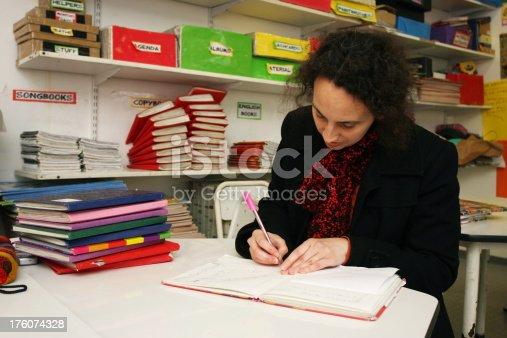840623374 istock photo Teacher Marking 176074328
