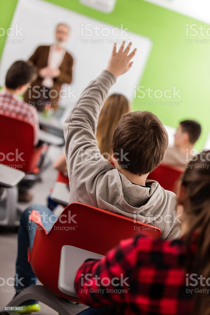 Teacher, may I ask something? stock photo
