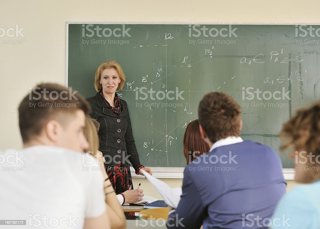 Teacher on a blackboard stock photo