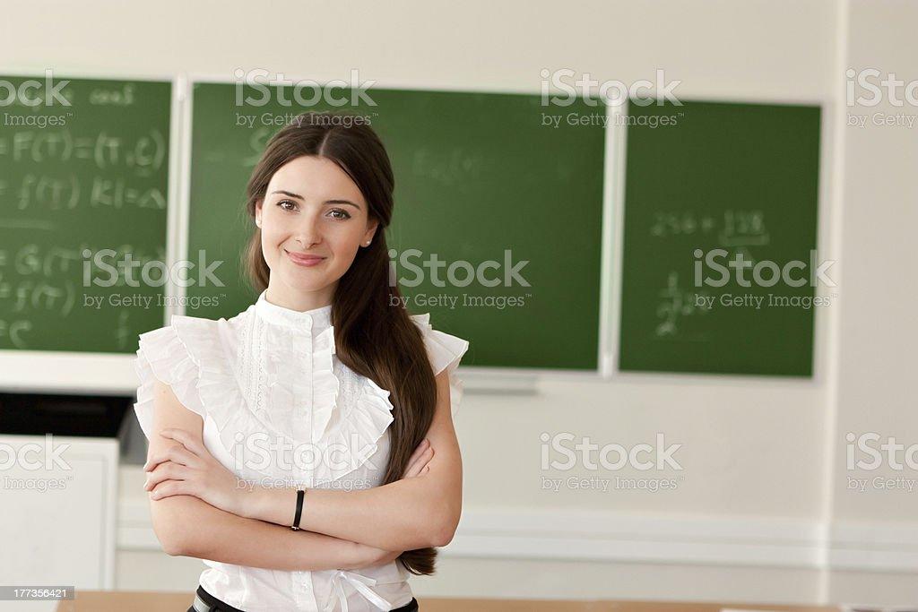 teacher on background of blackboard royalty-free stock photo